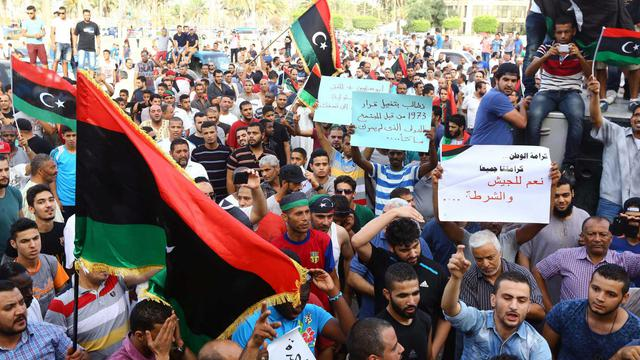 Manifestation de Libyens à Tripoli, le 31 juillet 2014, demandant  une intervention internationale pour protéger les civils [Mahmud Turkia / AFP]