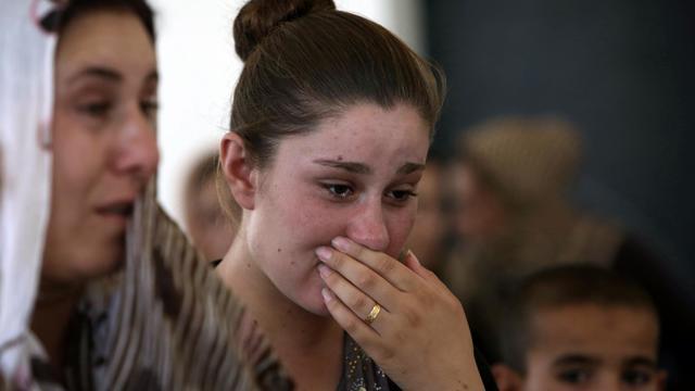 Une femme yazidie qui a fui la violence de son village de Sinjar en Irak, réfugiée dans une école au Kurdistan, le 5 août 2014 [Safin Hamed / AFP]