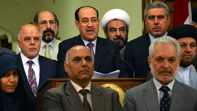 Le Premier ministre irakien Nuri al-Maliki annonce son départ au profit de son successeur Haidar al-Abadi (l), le 15 août 2014 [- / Iraqi Prime minister office/AFP]
