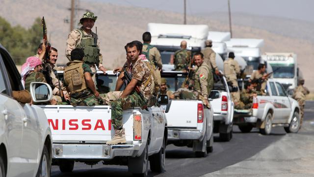Les Peshmergas irakiens avancent en direction du barrage de Mossoul repris aux jihadistes de l'Etat islamique (EI) le 17 août 2014, dans le nord de l'Irak [Ahmad Al-Rubaye / AFP]