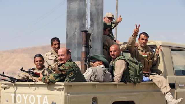 Des combattants peshmerga font route vers Mossoul le 17 août 2014 [Ahamad al-Rubaye / AFP]