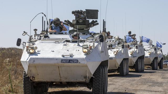 Un convoi de l'ONU sur le plateau du Golan, le 28 août 2014 [Jack Guez / AFP]