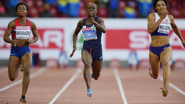 La Française Myriam Soumaré (c) lors de sa demi-finale du 100 m, le 13 août 2014 aux Championnats d'Europe à Zurich [Olivier Morin / AFP]