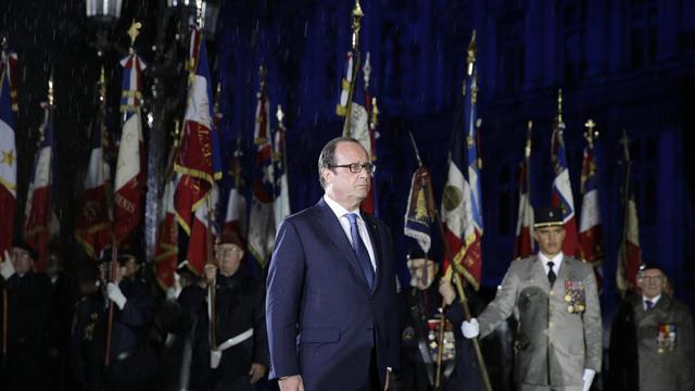 François Hollande lors de la célébration du 70e anniversaire de la Libération, le 25 août 2014 dans la soirée à Paris [Joël Saget / AFP]