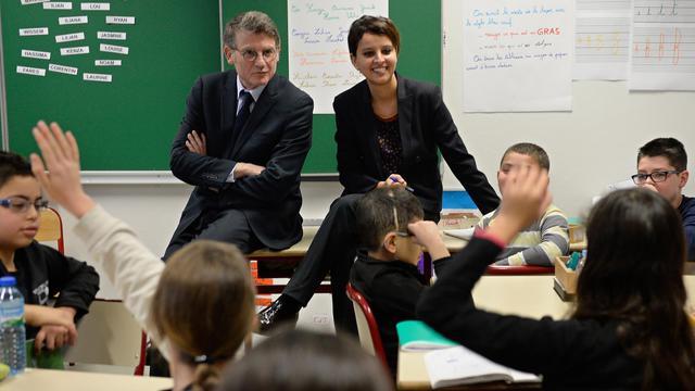 Vincent Peillon et Najat Vallaud-Belkacem lors d'une visite dans une école le 13 janvier 2014 à Villeurbanne  [Philippe Desmazes / AFP/Archives]