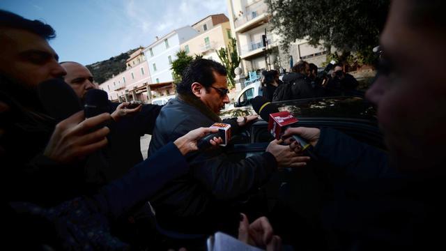 Le commandant du Costa Concordia, Francesco Schettino arrive à un hôtel, le 27 février 2014 au port du Giglio [Filippo Monteforte / AFP]