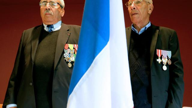 Des harkis et leurs descendants réclament la reconnaissance officielle de la France à Colombey-les-Deux-Eglises le 10 mai 2014 [François Nascimbeni / AFP]