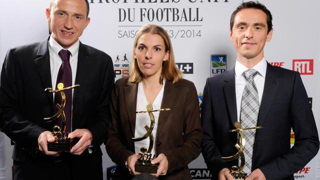 Ruddy Buquet, Stéphanie Frappart et Frédéric Canot lors de la cérémonie des Trophées UNFP, le 11 mai 2014 à Paris. [Jean-Marie Hervio / AFP/Archives]