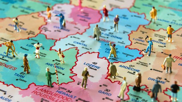 François Hollande a annoncé début juin une vaste refonte des régions et la disparition progressive des départements, dans le but de faire des économies [Philippe Huguen / AFP/Archives]