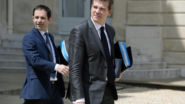 Benoît Hamon et Arnaud Montebourg dans la cour de l'Elysée à la sortie du Conseil des ministres  le 11 juin 2014 à Paris [Bertrand Guay / AFP/Archives]