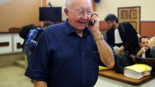 Le sénateur et président de la Polynésie française Gaston Flosse à la Cour d'appel de Papeete le 23 juin 2014 [Grégory Boissy / AFP/Archives]
