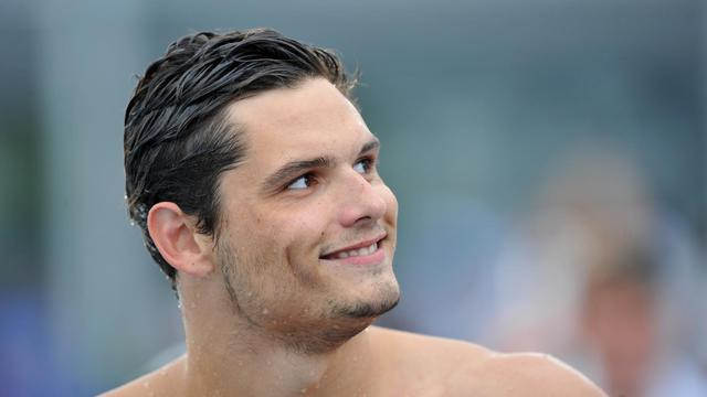 Le Français Florent Manaudou après l'épreuve de 50 m nage libre de l'Open de France, qu'il a remporté le 5 juillet 2014 à Vichy. [Thierry Zoccolan / AFP]