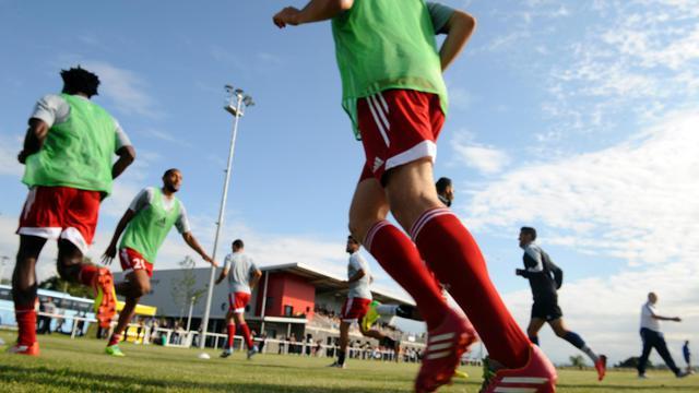 Les joueurs de Luzenac s'entraînent avant un amical face à Toulouse, le 12 juillet 2014 à Mazère, dans le sud [Rémy Gabalda / AFP/Archives]
