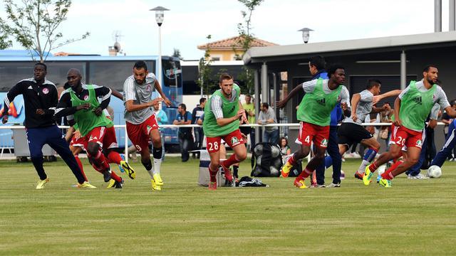 Les joueurs de Luzenac à l'échauffement avant un match amical contre Toulouse, le 12 juillet 2014 [Rémy Gabalda / AFP/Archives]