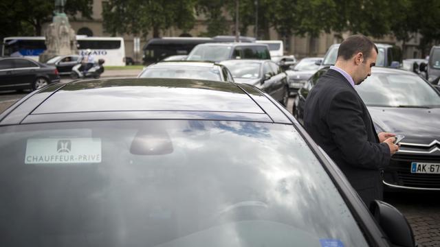 Un conducteur de voiture de tourisme avec chauffeur (VTC) à la manifestation du 21 juillet 2014 [Martin Bureau / AFP]