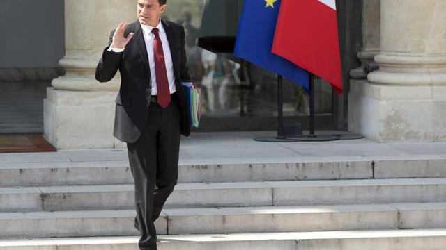 Manuel Valls quitte l'Elysée à l'issue du Conseil des ministres, le 30 juillet 2014 à Paris [Kenzo Tribouillard / AFP/Archives]