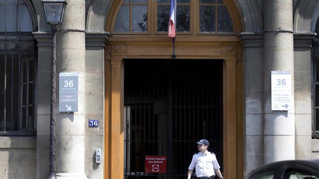 L'entrée de 36 quai des Orfèvres à Paris, le 6 aout 2014 [Kenzo Tribouillard / AFP]