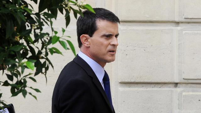 Le Premier ministre Manuel Valls quitte le Palais de l'Elysée après un séminaire gouvernemental à Paris, le 1er août 2014 [Dominique Faget / AFP]