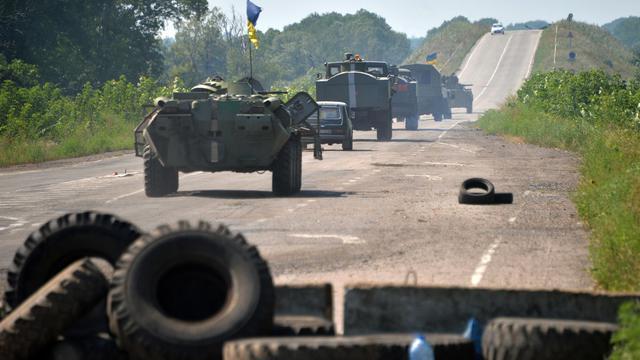 L'armée ukrainienne patrouille près de Debaltseve, dans la région de Lougansk, le 1er août 2014 [Genya Savoliv / AFP]