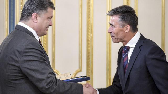 Le secrétaire général de l'Otan, Anders Fogh Rasmussen reçu le 7 août 2014 par le président ukrainien Petro Porochenko [Mykola Lazarenko / Presidential Press Service/AFP/Archives]
