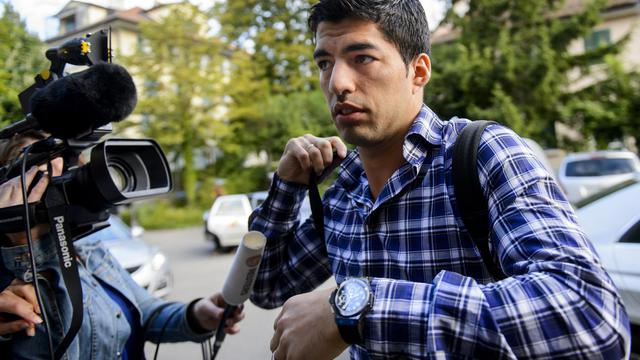 L'Uruguayen Luis Suarez à son arrivée devant le tribunal arbitral du sport à Lausanne, le 8 août 2014 [Fabrice Coffrini / AFP/Archives]