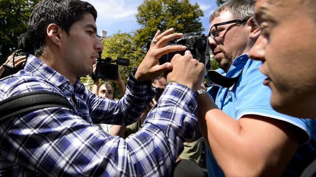 L'Uruguayen Luis Suarez à sa sortie du Tribunal arbitral du sport le 8 août 2014 à Lausanne [ / AFP]