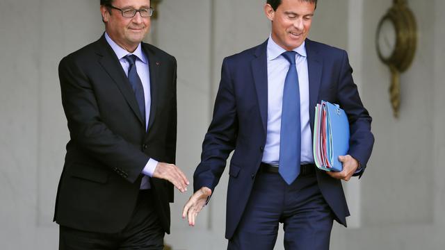 François Hollande et Manuel Valls  à la sortie du conseil des ministres le 20 août 2014 sur le perron de l'Elysée à Paris [Patrick Kovarik / AFP/Archives]