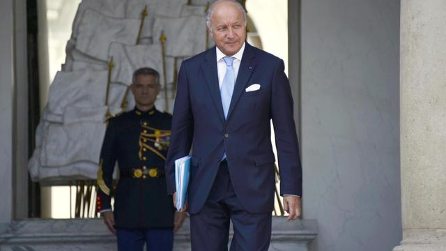 Laurent Fabius quitte l'Elysée, le 20 août 2014 à Paris [Bertrand Guay / AFP]