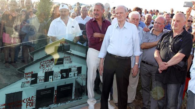 Edmond Simeoni lors de l'inauguration le 22 août 2014 à Aléria d'une stèle commémorant les événements du 22 août 1975 [Pascal Pochard-Casabianca / AFP]