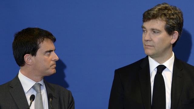 Manuel Valls (g) et Arnaud Montebourg, le 12 mai 2014 à Faverges [Philippe Desmazes / AFP/Archives]