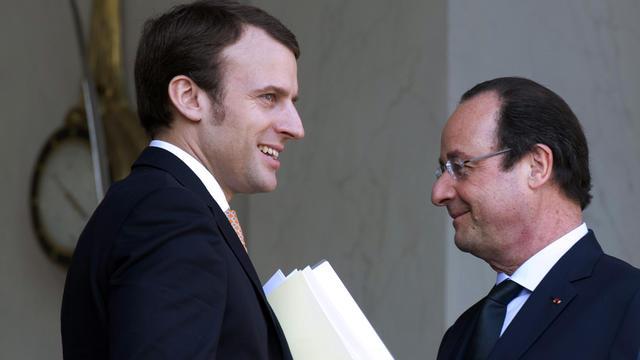 Emmanuel Macron, nommé ministre de l'Economie le 26 août 2014, à l'Elysée en compagnie de François Hollande le 26 mars 2014 [Alain Jocard / AFP/Archives]