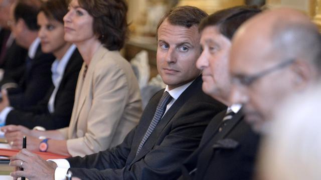 Le nouveau ministre de l'Economie Emmanuel Macron (c) lors du premier conseil des ministres du gouvernement Valls 2, le 27 aout 2014 à l'Elysée [Fred Dufour / POOL/AFP]