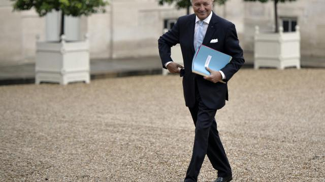 Le ministre des Affaires étrangères Laurent Fabius lors de son arrivée à l'Elysée pour le premier conseil des ministres du gouvernement Valls II [Fred Dufour / AFP]