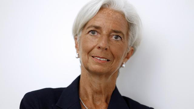 """Christine Lagarde dans le bureau de son avocat à Paris, le 27 août 2014, peu après l'annonce de sa mise en examen pour """"négligence"""" dans l'affaire de l'arbitrage Tapie [Thomas Samson / AFP]"""