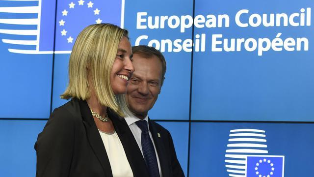 L'Italienne Federica Mogherini, nouvelle chef de la diplomatie européenne, et le Polonais Donald Tusk, nouveau président du Conseil européen, lors d'un sommet de l'UE à Bruxelles le 30 août 2014 [John Thys / AFP]
