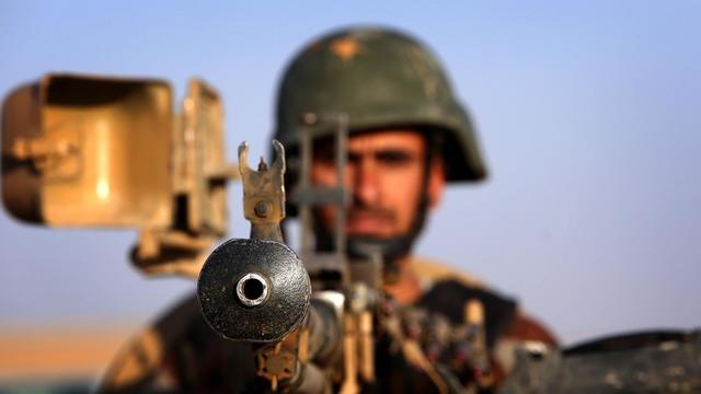 Un peshmerga au point de passage de Aski kalak (40 km de Arbil), le 14 août 2014 [Safin Hamed / AFP/Archives]