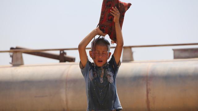 Un jeune irakien yazidi dans le camp de réfugié de Newroz dans le nord-est de la Syrie, le 14 août 2014  [Ahmad Al-Rubaye / AFP]