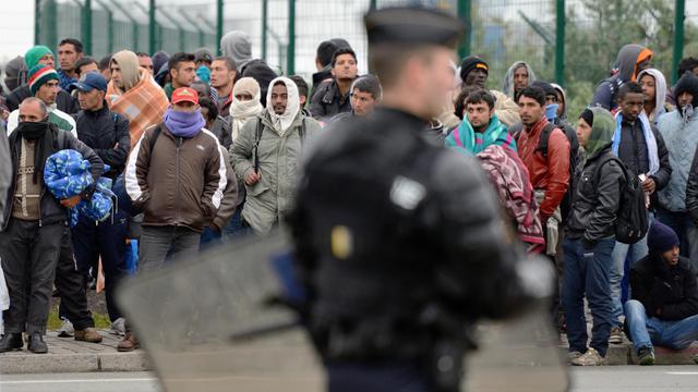Le 28 mai 2014, évacuation par la police d'un des camps de migrants à Calais [Denis Charlet / AFP/Archives]