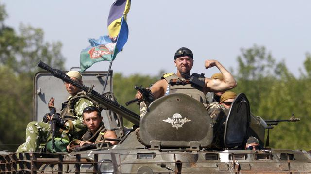 Des soldats ukrainiens dans un blindé dans la région de Donetsk, le 9 août 2014 [Anatolii Stepanov / AFP]
