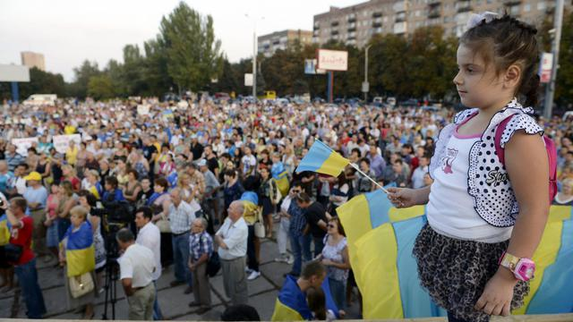 Manifestation à Marioupol dans la région de Donetsk le 28 aout 2014 demandant une Ukraine unie et le retrait des troupes russes [Alexander Khudoteply / AFP]