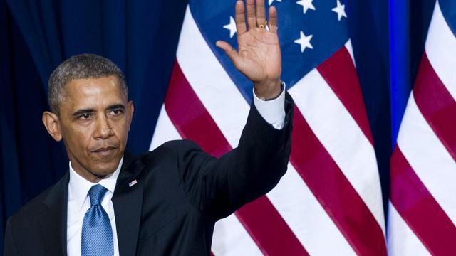 Le président Barack Obama salue les journalistes après une conférence de presse sur la réforme de la NSA à Washington le 17 janvier 2014 [Saul Loeb / AFP]
