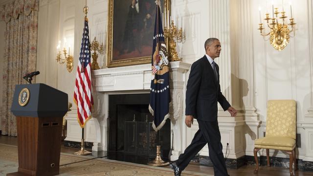 Le président américain Barack Obama quitte la conférence de presse à la Maison Blanche le 7 août après s'être exprimé sur l'Irak [Saul Loeb / AFP]
