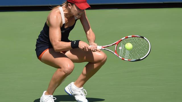 Alizé Cornet lors du match l'opposant à Daniela Hantuchova le 27 août 2014 à l'US Open de tennis à New York [Timothy A. Clary / AFP]