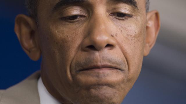 """Barack Obama en conférence de presse à Washington le 28 aout 2014 a reconnu sans détour que les Etats-Unis n'avaient """"pas encore de stratégie"""" et n'étaient pas prêts à ce stade à attaquer l'Etat islamique (EI) en Syrie [Saul Loeb / AFP]"""