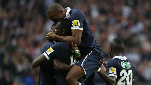 Les Bordelais fêtent le premier des deux buts de Cheick Diabaté face à Evian-Thonon, en finale de Coupe de France, le 31 mai 2013 au Stade de France [Thomas Samson / AFP]
