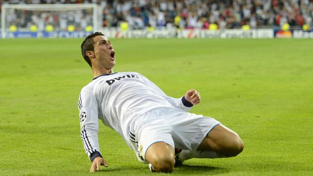 L'attaquant du Real Cristiano Ronaldo exulte après avoir inscrit le but de la victoire face à Manchester City, le 18 septembre 2012 à Madrid. [Pierre-Philippe Marcou / AFP]
