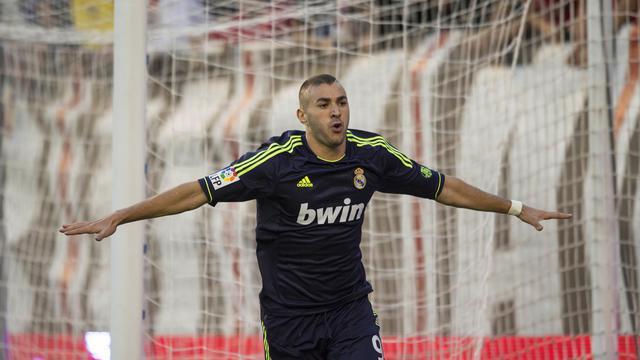 L'attaquant français du Real Karim Benzema, auteur du premier but des Madrilènes, sur le terrain du Rayo Vallecano, le 24 septembre 2012. [Dani Pozo / AFP]