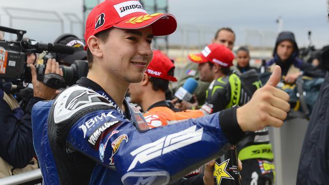 L'Espagnol Jorge Lorenzo, pilote Yamaha, ravi après avoir décroché la pole position du GP d'Aragon sur le circuit d'Alcaniz (Espagne), le 29 septembre 2012. [Pierre-Philippe Marcou / AFP]
