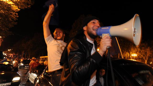 Des partisans de l'opposition à l'annonce des résultats le 1er octobre 2012 à Tbilissi [Andrey Smirnov / AFP]