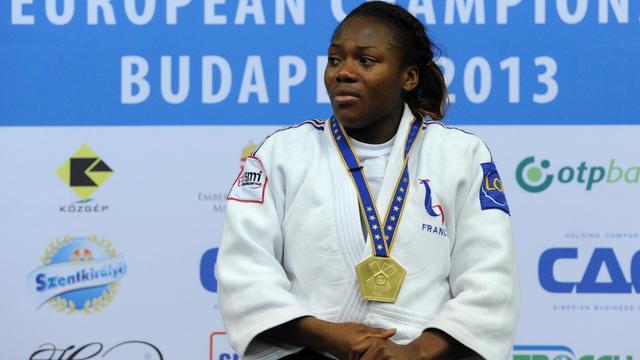 La Française Clarisse Agbegnenou sur la première place du podum des Championnats d'Europe à Budapest, le 28 avril 2013. [Attila Kisbenedek / AFP]